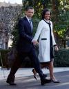 ميشيل أوباما ترتدي معطف من ثاكون بينما كانت تغادر البيت الابيض للزيارة الرئاسية  الاولى الى اوروبا
