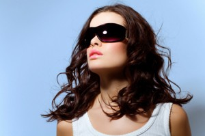 Beauty shot of a woman in large shades.