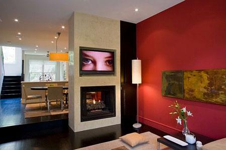 غرفة معيشة مع لون جدار احمر