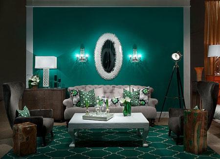 غرفة مزينة باللون الاخضر الزمردي