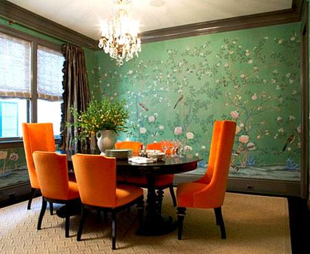 غرفة طعام باللون الاخضر والبرتقالي