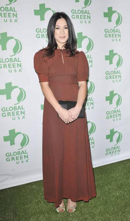ميشيل برانش بدت مريعة في هذا الفستان البني في حفل  Global Green USA ماقبل الاوسكار.